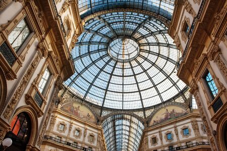 vittorio emanuele: Low angle view toward circular domed ceiling and windows inside the Vittorio Emanuele Milan shopping mall interior