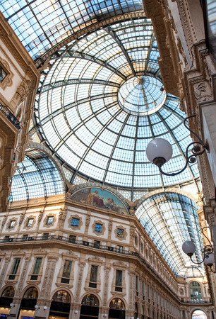 vittorio emanuele: Low angle view of corridors and circular domed ceiling and windows inside the Vittorio Emanuele Milan shopping mall interior Editorial