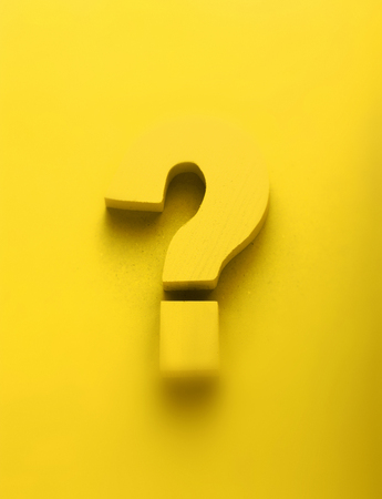 unsolved: 3d yellow question mark on a vibrant colorful yellow background with feint shadow and copy space in a conceptual image