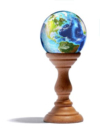 plinth: Fortuneteller glass globe showing the continents and oceans of the Earth on a wooden plinth or stand over a white background Stock Photo
