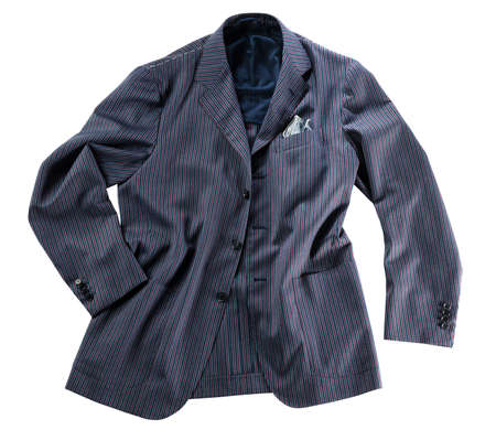 loosely: Loosely arranged tailor made blue pin striped jacket with handkercheif in pocket over isolated white background