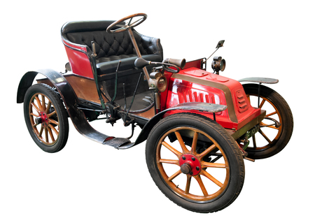 Isolated old red, brown and black Isotta Fraschini car with cushioned leather seats and mudguards from 1906