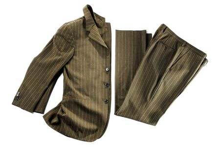 Partially folded brown pin striped suit jacket and pants as isolated formal wear apparel on white background