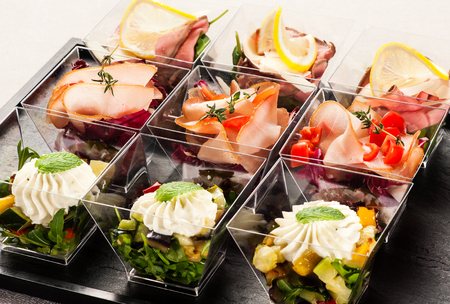 glass containers: Cute rectangular slanted glass containers filled with delicious appetizers made of fruit, meat and herbs