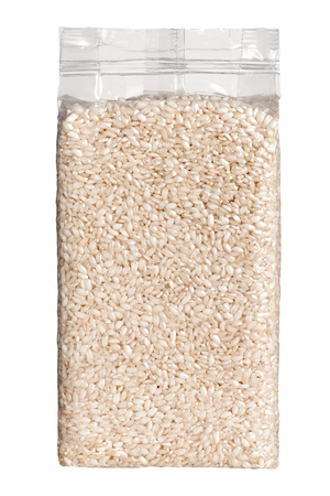 packed: Vacuum packed plastic pack of long grain rice front viewVacuum packed plastic pack of long grain par-boiled husked white rice isolated on a white background, viewed at front Stock Photo