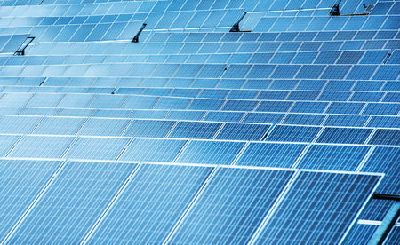 converting: Photovoltaic solar panels in a close up full frame background view for converting the solar energy of the sun to electricity Stock Photo