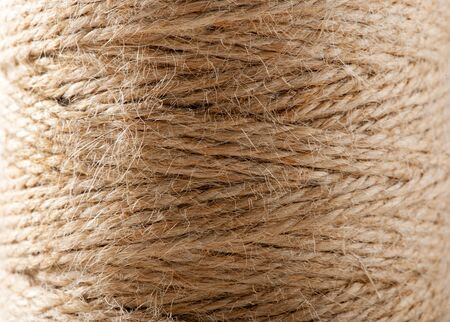 twine: Close up background texture of brown twine wound on a reel showing the natural hemp fibers used in production Stock Photo