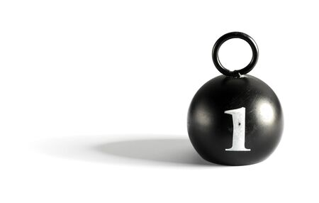 Old round black 1 kilogram counterpoise weight with handle on a white background with copy space and shadow Stock Photo