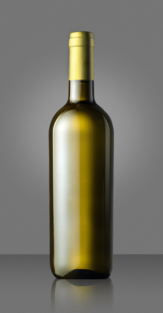 unlabelled: Single unlabelled full corked green white wine bottle on grey in a concept of viticulture, wine making, tasting or a winery branding
