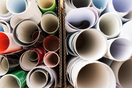 selections: Close-up from above view of bunch of white printing paper rolls and colored films inside cartoon boxes. Background concept Stock Photo