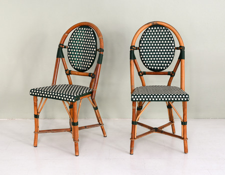 upholstered: Pair of bamboo chairs with polka dot upholstery in modern room