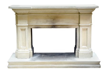 Old vintage marble or stone fire surround with carved columns and mantelpiece and smoke stains in the center isolated on white Stock Photo