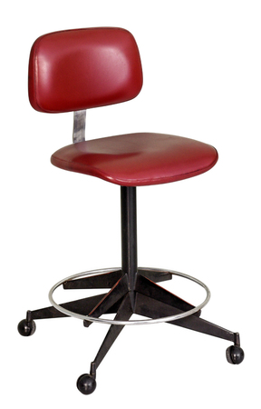 Vintage sixties red revolving stool on black metal legs and casters isolated on white