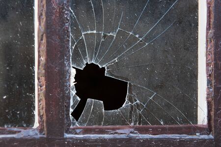 Close-up of old broken window glass in frame