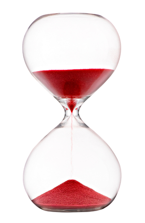 Red sand running through an hourglass with clear glass bulbs measuring passing time counting down to a deadline isolated on white
