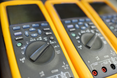 Close up view of yellow multimeters or multitester Stock Photo