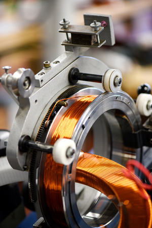Electric transformers with copper wire at assembling line in close up view Reklamní fotografie