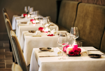 Romantic Table Settings In A Restaurant With Centrepieces Of Stock - Restaurant table candles