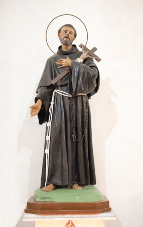 Religious Statue of Saint Francis of Assisi, patron saint of animals and nature and founder of the Franciscan Order over a white background