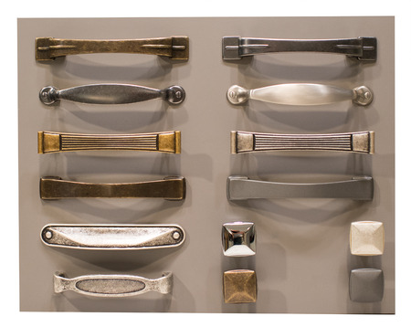 Designer chart with assorted metallic handles and door knobs for interior furnishing and decor