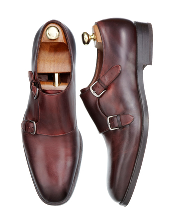 Pair of new elegant handmade mens shoes of brown leather with double monk strap buckle, viewed from above and the side, isolated on white background Banco de Imagens