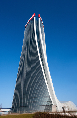 Full length view of the Generali Tower, Milan by architect Zaha Hadid with a modern design warping on its axis in a graceful curve