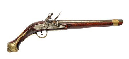 Vintage old hand gun, flintlock pistol, viewed from the side, isolated on white background