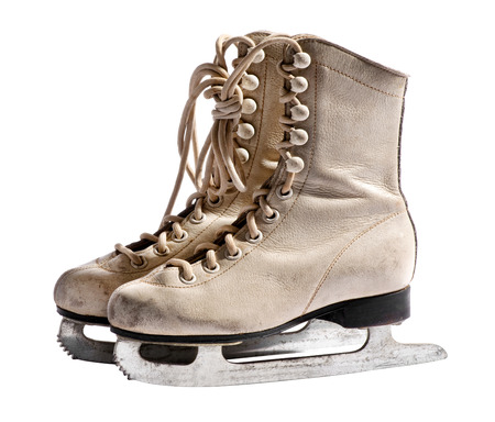 Old used white leather ice skates isolated on white background