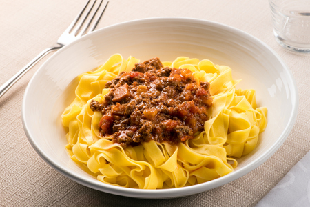 Regional dish of Taglietelle al ragu, from Emilia Romagna region of Italy with spaghetti pasta topped with savory minced meat and carrots Stock fotó