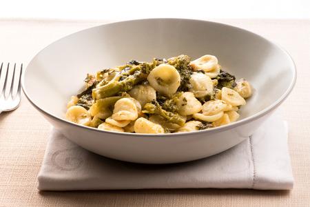 Bowl of Orecchiette Con Cime di Rapa, or orecchiette pasta with broccoli rabe, from Puglia, a traditional Italian dish Banco de Imagens