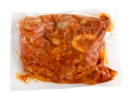 Vacuum packed meal of prepared ossobucco with veal in a wine and fruit sauce in an air-tight plastic bag for freezing or to extend shelf life Stock fotó
