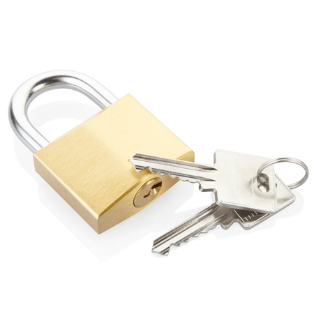 Padlock and key isolated on white background photo