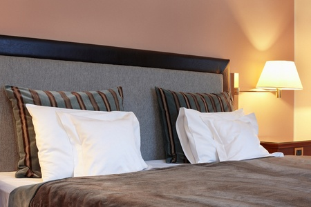 Hotel bedroom, bed and pillow photo