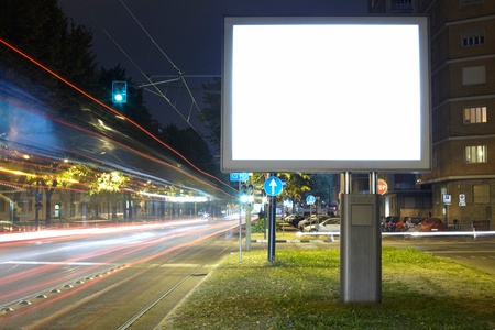 outdoor advertising: Billboard in the street at night