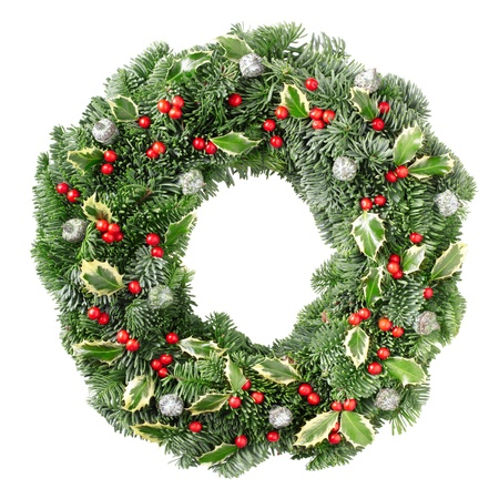 Christmas pine wreath and holly isolated on white background Stock Photo