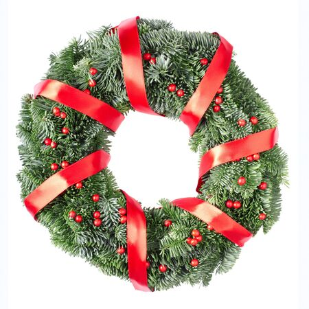 Christmas pine wreath and red holly berries isolated on white background photo