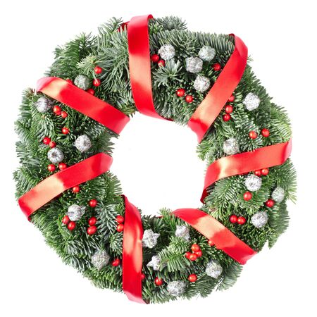 Christmas pine wreath and red ribbon isolated on white background photo