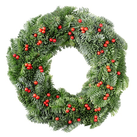 Christmas pine wreath and red berries isolated on white background photo