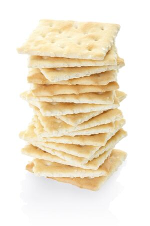 Crackers pile on white, clipping path included photo