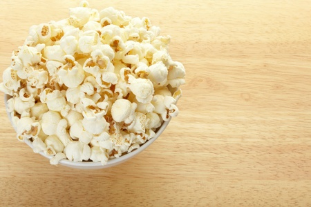 Popcorn bowl on table photo