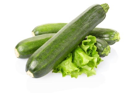 vegetable marrow: Zucchini isolated on white