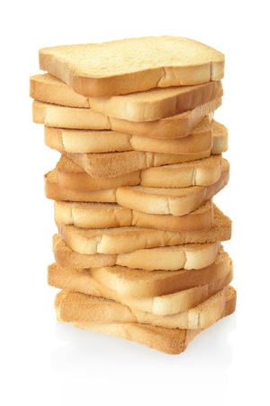 Toasted rusk bread pile on white photo