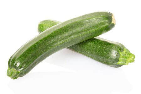 Zucchini or courgettes on white photo