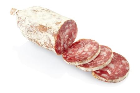 salami: Salami en rodajas aislado en blanco Foto de archivo