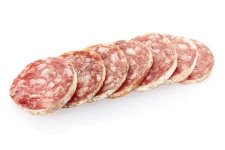 Salami slices on white Stock Photo - 13539387