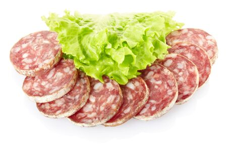 Salami with salad isolated on white photo
