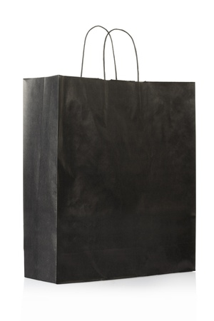 carry bags: Black paper bag on white Stock Photo