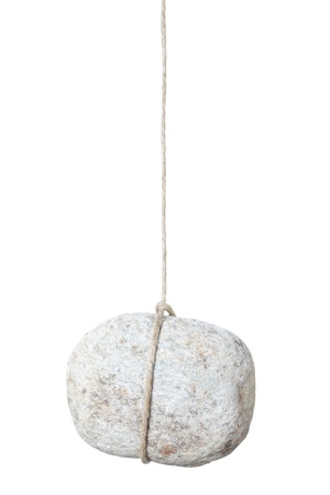 Stone hanging by a string isolated on white photo