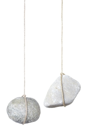 dangle: Stone hanging by a string isolated on white