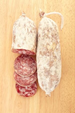 Sliced salami on cutting board Stock Photo - 14048490